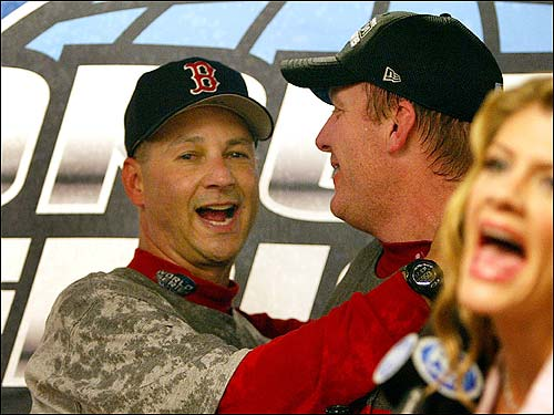 Terry Francona hugs Curt Schilling before a television interview.