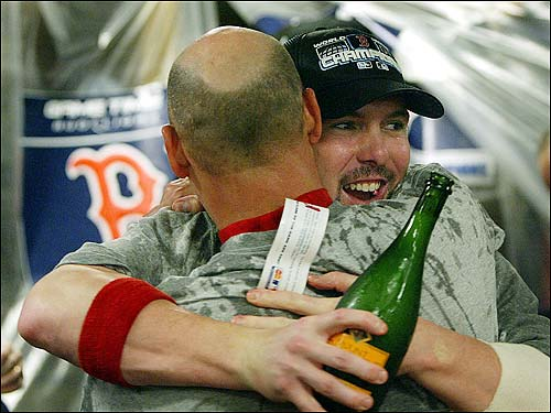 Terry Francona has a hug for Trot Nixon.