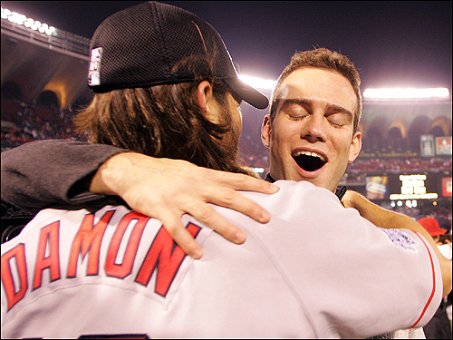 Johnny Damon embraces Theo Epstein.