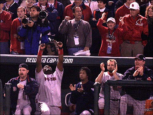 David Ortiz points skyward with two outs in the ninth just before Red Sox players stormed the field.