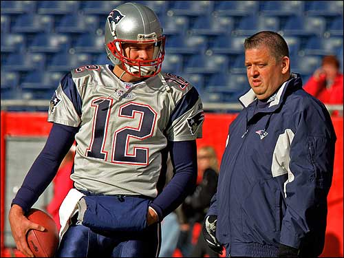 Patriots offensive coordinator Charlie Weis talks with Tom Brady during warm ups before the start of the game. Officials at Notre Dame University announced Sunday that they signed Weis to a six-year contract as head football coach.