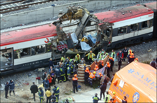 Terrorism and elections dominated world news in 2004, along with a horrific and ongoing tragedy in Africa. In March, rescue workers covered up bodies near a bomb-damaged passenger train after a number of explosions on trains in Madrid, Spain, that country's worst terrorist attack ever.