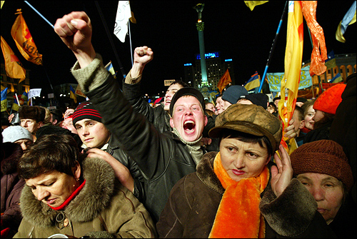 Supporters of Ukrainian opposition leader Viktor Yushchenko cheered on a rock band on Independence Square in Kiev in December. Mass protests erupted after his opponent was declared the winner of an election which the nation's highest court later ruled was tainted by corruption.