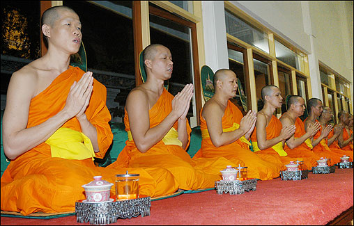 Thai monks pray for victims of the earthquake and tsunami at Saket Temple in Bangkok.