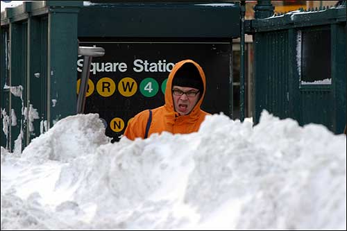 A subway rider stepped out of a subway station in New York City and faced piles of snow today.