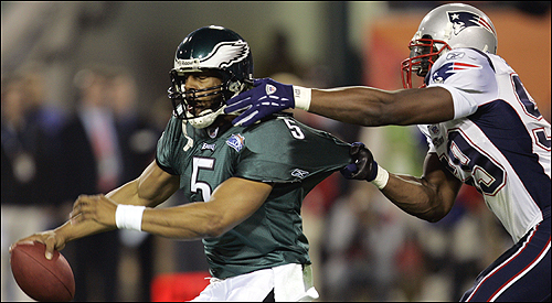 McNabb (5) tries to escape the grasp of Rosevelt Colvin.