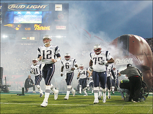 Tom Brady leads his team onto the field before the start of Super Bowl XXXIX against the Philadelphia Eagles at Alltel Stadium.