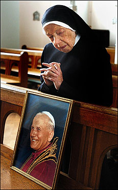 Sister Gregory, a 94-year-old nun at the Bar Convent in York, prayed in the convent chapel over an image of the pontiff.