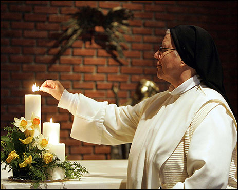 Sister Anne-Lise Strom of the Catholic Lunden convent in Oslo lit a candle during a prayer session for Pope John Paul II.