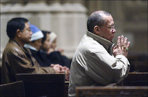 A member of the congregation prayed during the 7 a.m. Mass at Saint Patrick's Cathedral in New York, which included a special prayer for Pope John Paul ll.