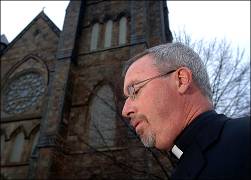 Archdiocese spokesman, the Rev. Christopher Coyne, spoke to reporters outside Cathedral of the Holy Cross in Boston after the death of Pope John Paul II.
