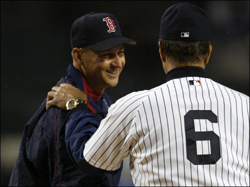 Red Sox manager Terry Francona shakes hands with Yankees manager Joe Torre at home plate before Sunday's season opener.