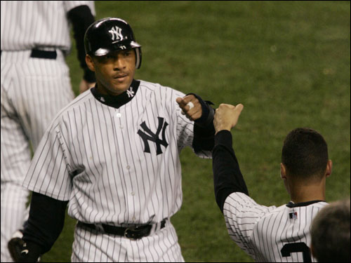 New York Yankees' right fielder Gary Sheffield is greeted by Derek Jeter after scoring on a hit by Hideki Matsui against during the third inning.