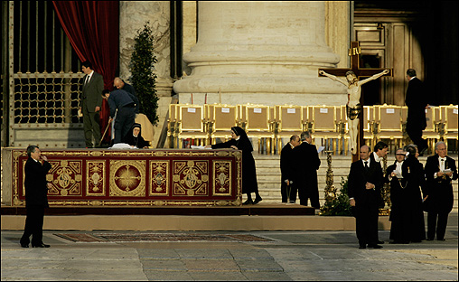 Nuns cleaned the altar during preparations for the funeral, which was one of the largest Western religious gatherings of modern times.