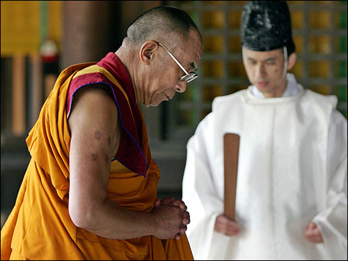 The Dalai Lama, the Tibetan spiritual leader, prayed at the Meiji Shrine in Tokyo Friday. The Dalai Lama, who arrived in Japan earlier in the day, urged people to carry on Pope John Paul II's legacy of peace.