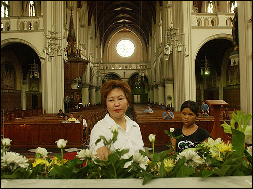 A woman decorated the altar with flowers for an evening Mass in memory of Pope John Paul II at a cathedral in Jakarta.