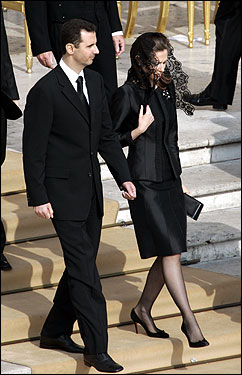 Syrian President Bashar Assad and his wife Asmaa arrived at the funeral.