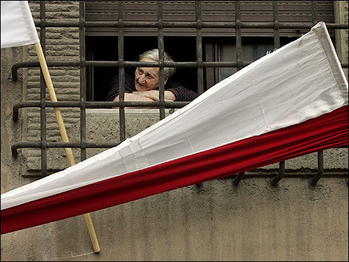 An Italian woman watched the funeral Mass in St. Peter's Square from a window.