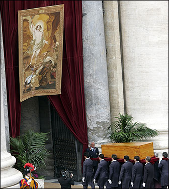 The coffin of Pope John Paul II was carried into St. Peter's Basilica for burial following the funeral Mass.
