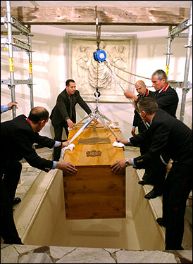 Pope John Paul II's coffin was lowered into the grave beneath St. Peter's Basilica.
