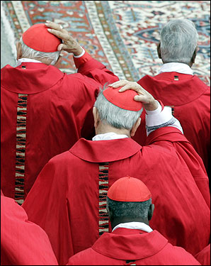 Cardinals held on to their skullcaps as a gust of wind blew during the funeral Mass in St. Peter's Square.