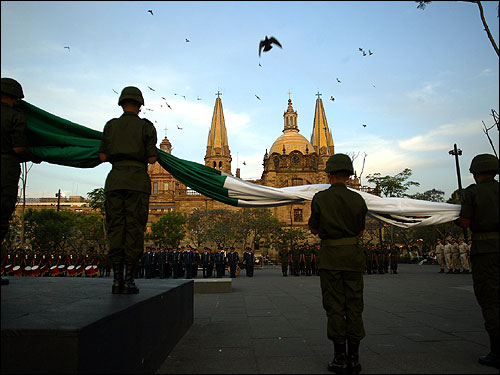 Mexican soldiers held the national flag as it was put at half staff at the Liberacion Plaza in Guadalajara City.