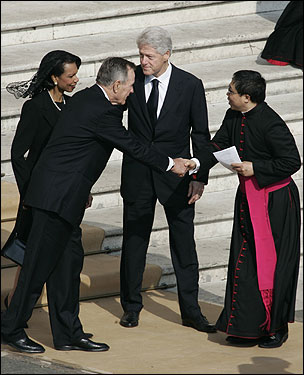 Former President George H.W. Bush shook hands with a bishop as former President Bill Clinton and Secretary of State Condoleezza Rice looked on.