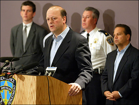 Flanked by Attorney General Patrick Lynch (L) and Mayor David Cicilline, Providence Police Chief Dean M. Esserman discussed the shooting.