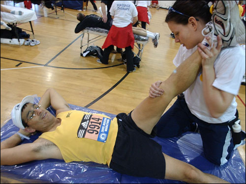 Richard Martinez, of Oro Valley, Ariz., got help stretching from volunteer massage therapist Melanie Laplante, of Ottawa, Ontario.
