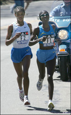 Defending Boston Marathon champion Catherine Ndereba of Kenya (right) caught up with Ethiopian runner Elfenesh Alemu in Newton. Ndereba won the race with a time of 2:25:13, and Alemu came in second.