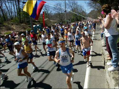 Spectators cheered and waved flags near the start of the race in Hopkinton.