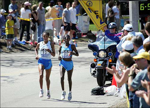 Catherine Ndereba of Kenya (right) caught up with Ethiopian runner Elfenesh Alemu in Newton during the 109th Boston Marathon.