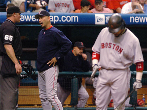 On April 24, a series of purpose pitches and two bench-clearing incidents resulted in suspensions and/or fines for eight uniformed personnel. Terry Francona, center, talks with home plate umpire Ted Barrett after Lance Carter threw a pitch behind Manny Ramirez, right, in the top of the seventh. Manny hit the next pitch out of the park.