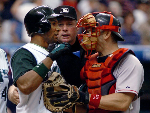 Red Sox catcher Jason Varitek, right, and home plate umpire Ted Barrett, center, prevent Singleton from approaching the mound after he was hit by a pitch from Arroyo. Singleton was fined.