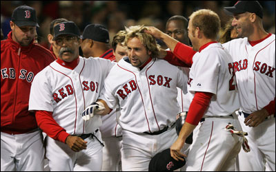 Kevin Millar is mobbed by teammates after hitting a walkoff homer in the bottom of the ninth.