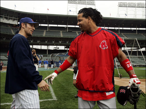 Nomar Garciaparra chats with former teammate Manny Ramirez before the start of today's game at Wrigley.