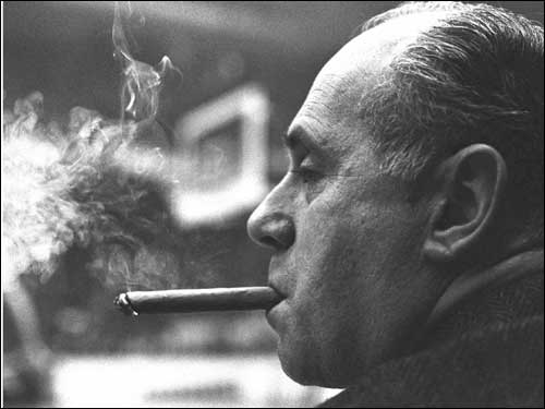Auerbach lit up a cigar as the Celtics take a commanding lead in a 1966 game against the Lakers. It would be Auerbach's 1,000th victory in Boston.