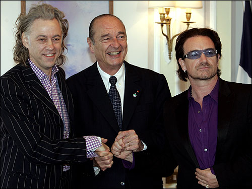 Irish rock singers Bono (right) and Bob Geldof (left) met with French President Jacques Chirac prior to a meeting on the sidelines of the G-8 Summit at Gleneagles in Scotland today. World leaders, shaken by deadly bombings in London, were convening for the final day of the global economic summit.