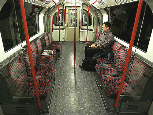 A lone commuter sat on the Central Line of the subway in London today.