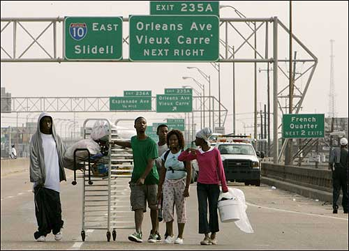 Residents pushed a cart with belongings on the raised section of Interstate 10 in New Orleans on Tuesday.