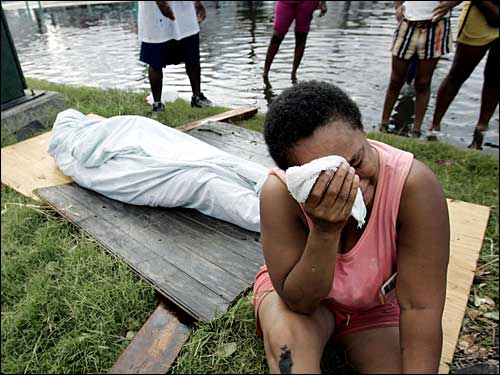 Evelyn Turner cried alongside the body of her common-law husband, Xavier Bowie, after he died in New Orleans. Bowie and Turner had decided to ride out Hurricane Katrina when they could not find a way to leave the city. Bowie, who had lung cancer, died when he ran out of oxygen Tuesday afternoon.