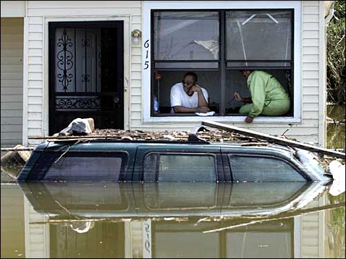 Darrell and Britney Maryland sat in their flooded home in the 9th Ward of New Orleans on Tuesday. They did not want to be rescued.