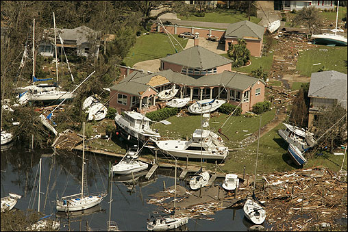 Boats of all types and sizes sat aground near a waterfront neighborhood in Ocean Springs, Miss.