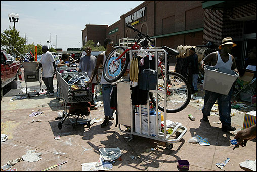 People removed goods from a closed Super Wal-Mart in the Garden District of New Orleans yesterday.