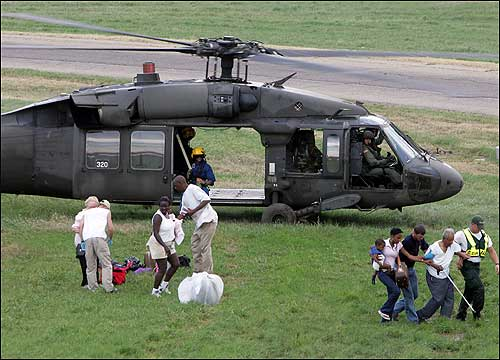 A military helicopter landed to offload flood evacuees near a strip of Interstate 10 in Metarie, La., on Wednesday.