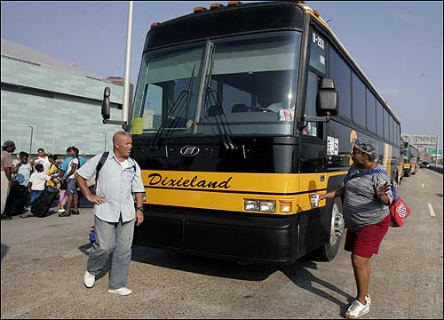 New Orleans residents congregated near an evacuation bus on Interstate 10 near the Superdome on Wednesday.