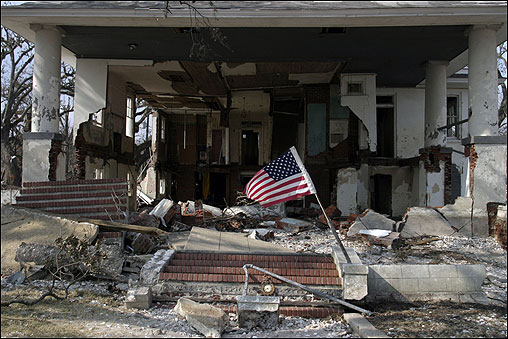 An American flag was posted outside a house destroyed by Hurricane Katrina in Biloxi, Miss.