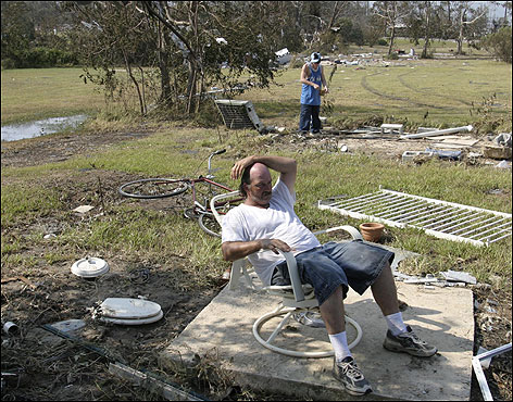 James Middleton relaxed after searching the remains of what was his three-bedroom house in D'lberville, Miss.