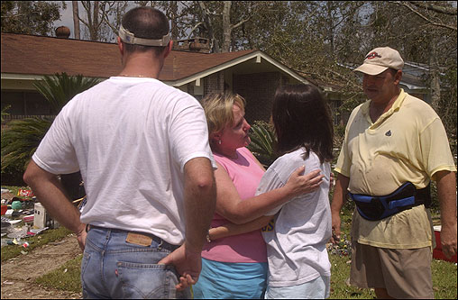 Margaret Wood of Ocean Springs, Miss., (second from left), comforted her daughter, LeAnn Smith, as Smith saw her family and their home for the first time after Hurricane Katrina.