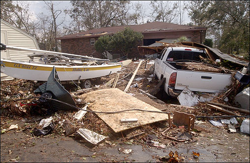 Debris sat outside a home in Ocean Springs, Miss., after water from Biloxi Bay rushed through homes on the Gulf Coast.